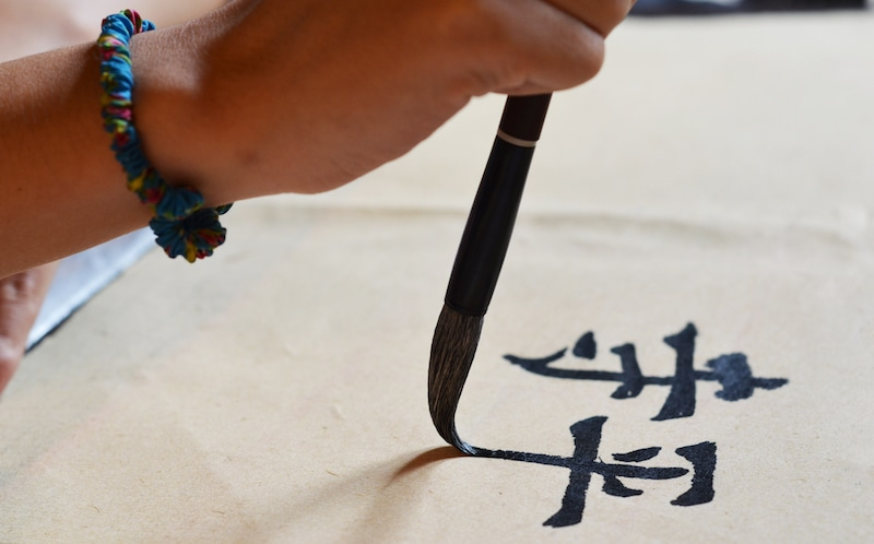 Practicing calligraphy during the Siping session 2015